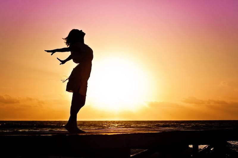 woman-happiness-sunrise-silhouette-40192